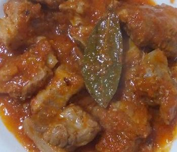 preparación de Receta de Costillas de Cerdo en Tomate